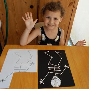 Easy Halloween DIY Earbud Skeleton